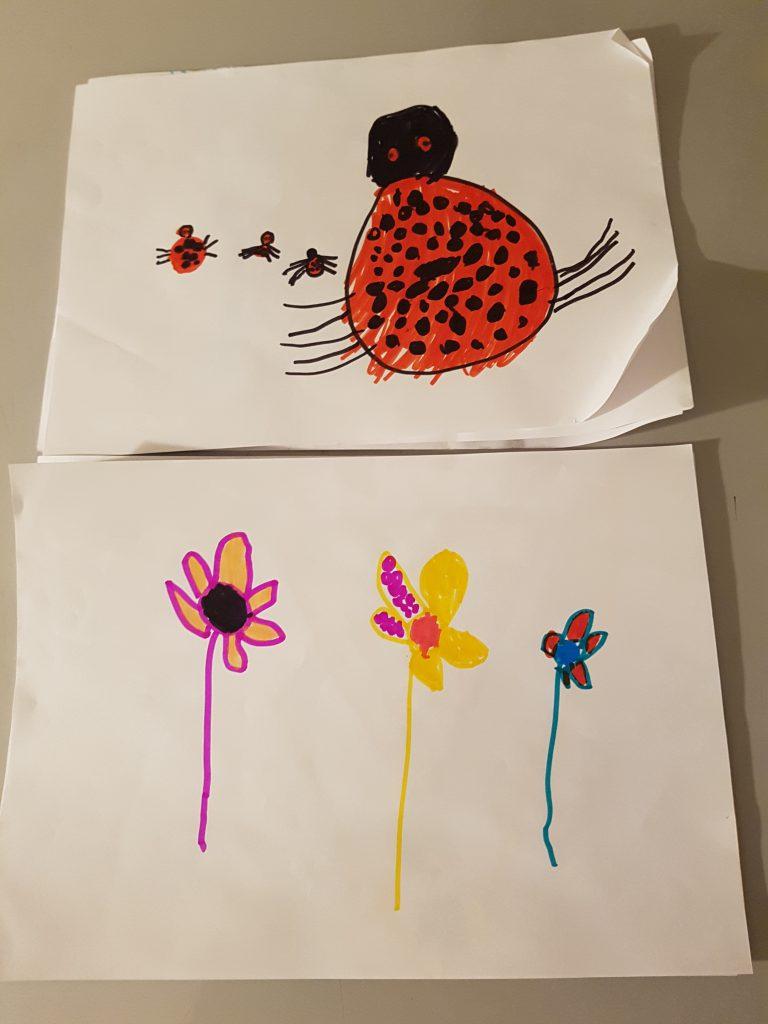 Ida har tegnet en mariehøne-familie og tre blomster